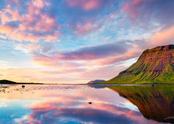 Colorful summer sunset with Kirkjufell mountain in Grundarfjordur in West Iceland
