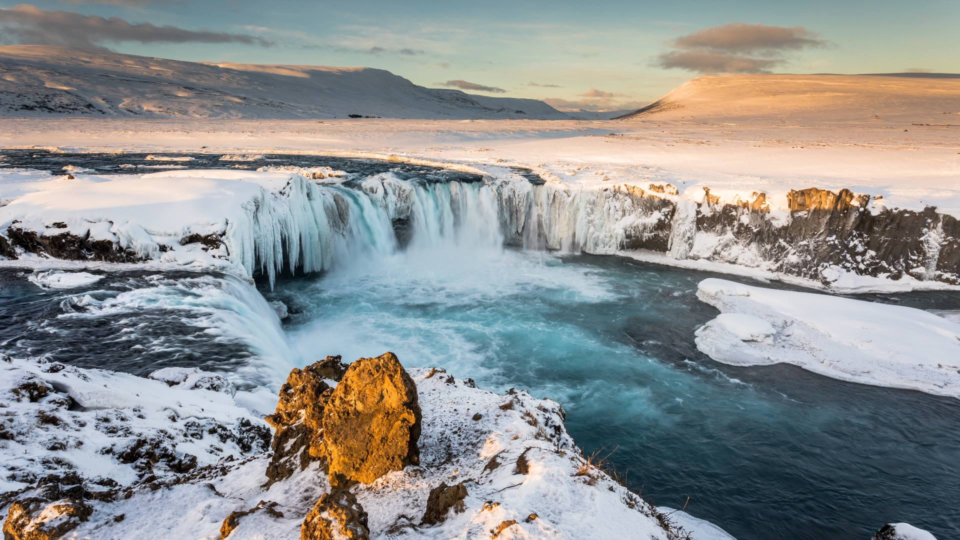 Huge icicles dangle over the Goðafoss waterfall in North Iceland.
